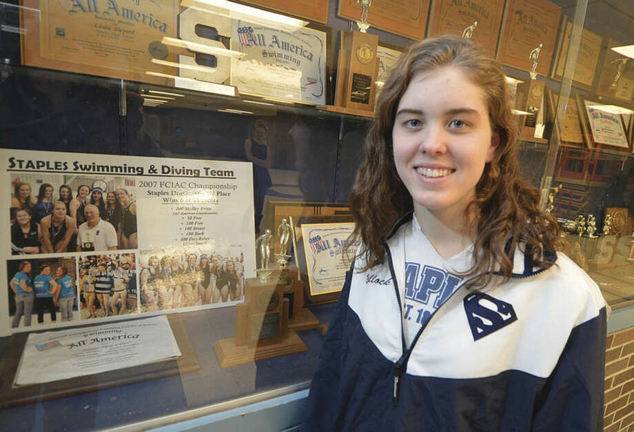 Hour photo/Alex von KleydorffMia Bullock, The Hour's 2014 All-Area MVP, helped add some more hardware to the Staples swimming trophy case this season.