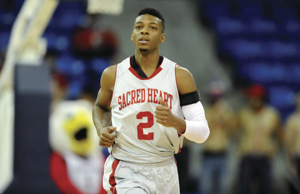 Courtesy of Sacred Heart Former Norwalk High standout Evan Kelley is helping turn things around with the Sared Heart basketball team that won just five games last season.