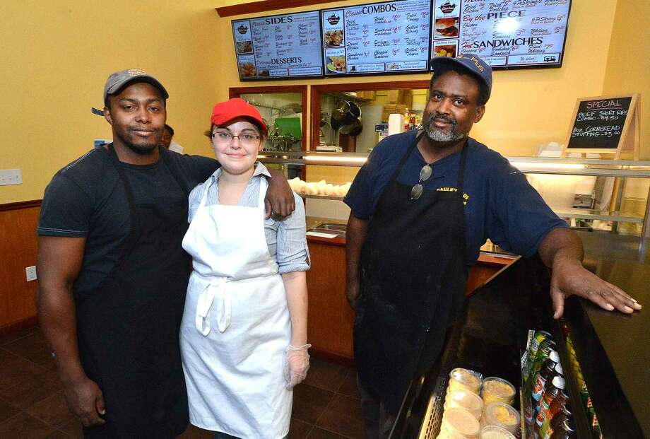 Hour Photo/Alex von Kleydorff Soul Food's staff Fred Paulk Jr. Katrina Pilver and Fred paulk Sr. in their new Norwalk restaurant