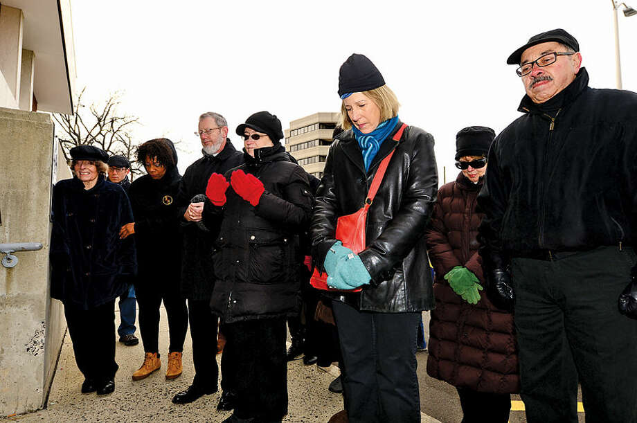 Hour photo / Erik Trautmann Members of the community dressed in black attend the Stamford NAACP sponsored march from First Congregational to the Stamford Police Department and courthouse where they prayed Saturday in response to two grand jury decisions this past month not to indict white police officers in the deaths of two black men.