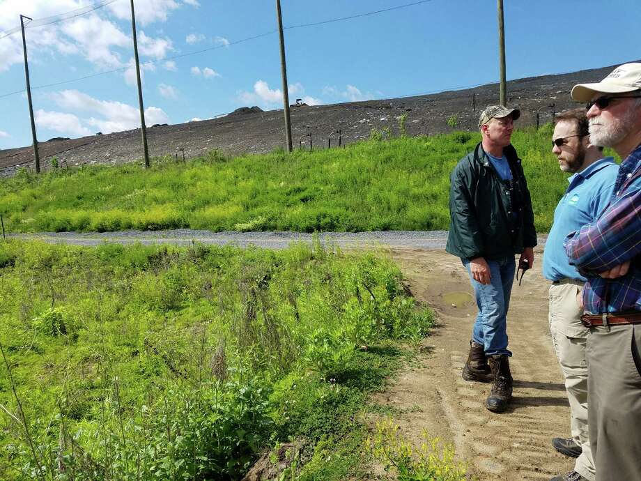 Neil Gifford, conservation director for the Albany Pine Bush Preserve Commission, leads a tour of the newly planted native plants area next to the Rapp Road landfill.