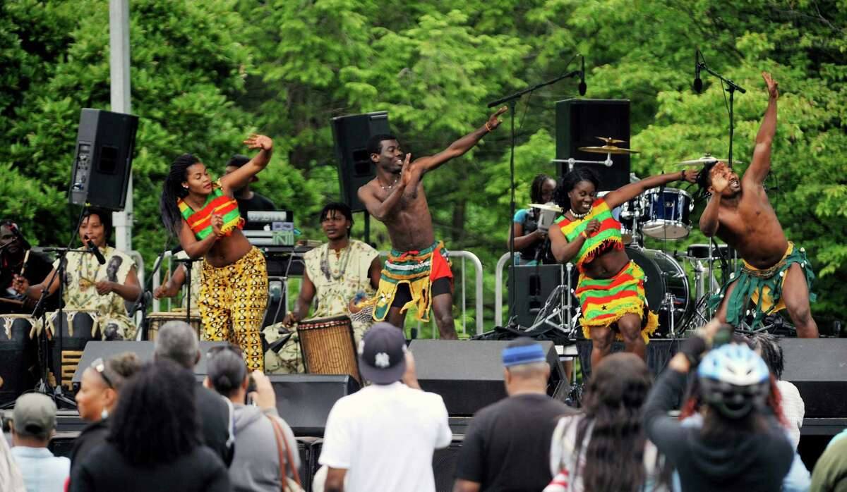 Members of the Tsoloi Ensemble perform a traditional African dance at the Juneteenth celebration at Washington Park on Sunday, June 12, 2016, in Albany, N.Y. Juneteenth has long been a celebration of freedom, as the date represents the time when the last slaves in America were freed after emancipation. (Paul Buckowski / Times Union)