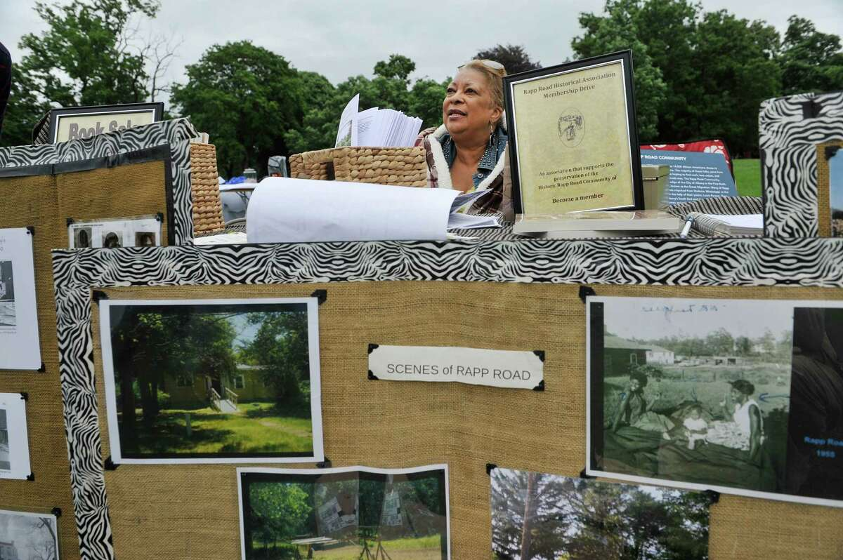 Beverly Bardeques with the Rapp Road Historical Association talks with visitors at her display at the Juneteenth celebration at Washington Park on Sunday, June 12, 2016, in Albany, N.Y. The Rapp Road Historical Association is working to raise money to rehab homes in the Rapp Road community, which was settled by African American migrating north. Bardeques who lives in the community is a descendant of the settlers. Juneteenth has long been a celebration of freedom, as the date represents the time when the last slaves in America were freed after emancipation. (Paul Buckowski / Times Union)