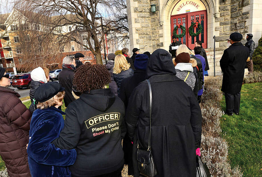 Hour photo / Erik Trautmann Members of the community dress in black to attend the Stamford NAACP sponsored march from First Congregational to the Stamford Police Department and courthouse Saturday in response to two grand jury decisions this past month not to indict white police officers in the deaths of two black men.