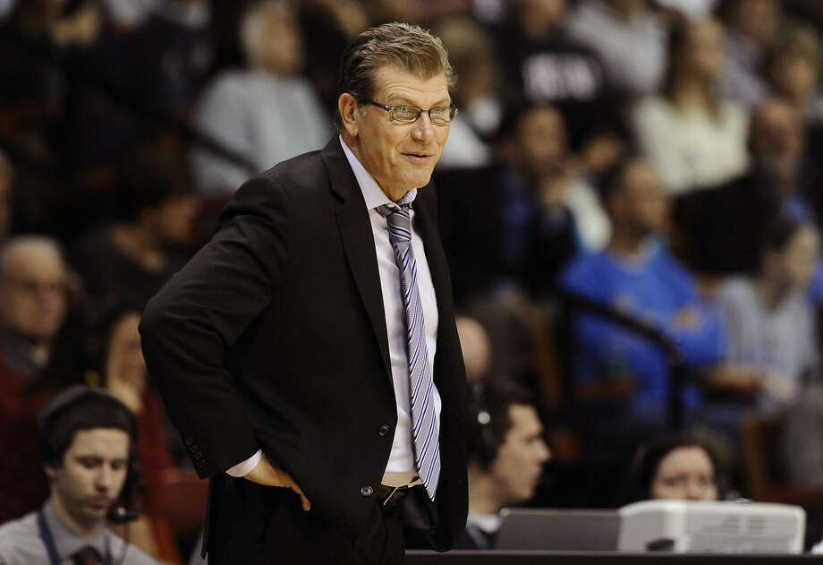 Connecticut Geno Auriemma reacts to a call during the second half of an NCAA college basketball game against UCLA, Sunday, Dec. 21, 2014, in Uncasville, Conn. Connecticut won 86-50. (AP Photo/Jessica Hill)