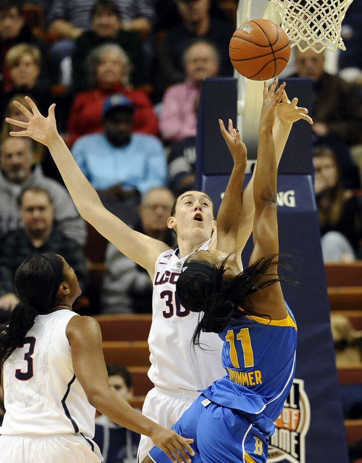 Connecticut's Breanna Stewart, left, blocks a shot attempt by UCLA's Lajahna Drummer, right, during the first half of an NCAA college basketball game, Sunday, Dec. 21, 2014, in Uncasville, Conn. (AP Photo/Jessica Hill)