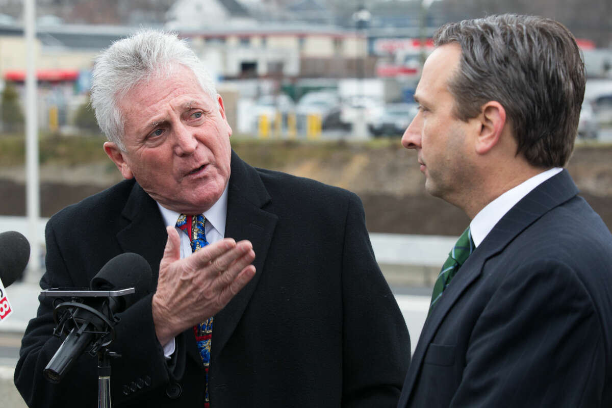 Hour photo/Chris Palermo. Norwalk Mayor Harry Rilling speaks alongside State Senator Bob Duff during a press conference held to announce the opening of new