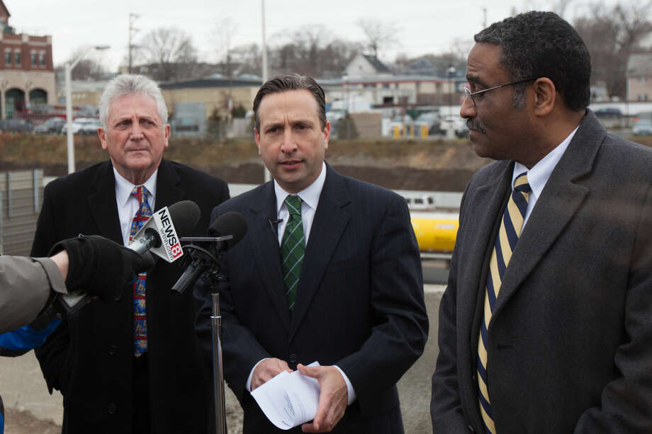 "Hour photo/Chris Palermo. State Senator Bob Duff (D-Norwalk) speaks alongside and Norwalk Mayor Harry Rilling and State Rep. Bruce Morris during a press conference held to announce the opening of new ""speed change"" lanes on I-95 in Norwalk Monday morning, which is five months ahead of schedule."