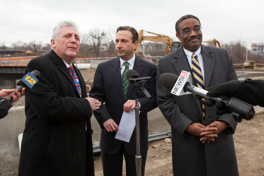 "Hour photo/Chris Palermo. Norwalk Mayor Harry Rilling speaks alongside State Senator Bob Duff and State Rep. Bruce Morris during a press conference held to announce the opening of new ""speed change"" lanes on I-95 in Norwalk Monday morning, which is five months ahead of schedule."