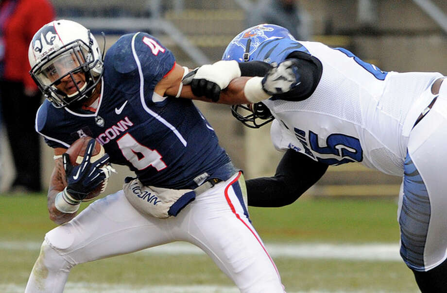 Connecticut wide receiver Deshon Foxx (4) is tackled by Memphis defensive lineman Latarius Brady (85) during the first half of an NCAA college football game in East Hartford, Conn., on Saturday, Dec. 7, 2013. (AP Photo/Fred Beckham) / FR153656 AP