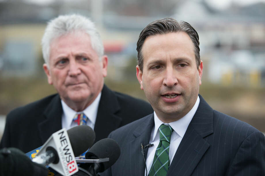 """Hour photo/Chris Palermo. State Senator Bob Duff (D-Norwalk) and Norwalk Mayor Harry Rilling speak during a press conference held to announce the opening of new """"speed change"""" lanes on I-95 in Norwalk Monday morning, which is five months ahead of schedule."""