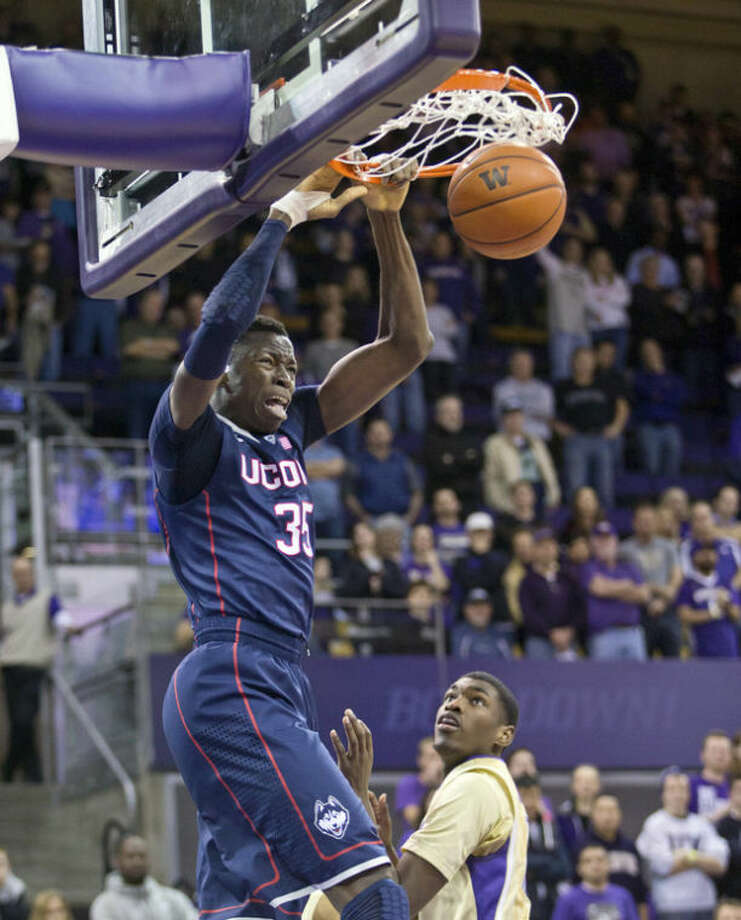 Connecticut's Amida Brimah dunks against Washington in the first half of an NCAA college basketball game in Seattle on Sunday, Dec. 22, 2013. (AP Photo/John Froschauer)