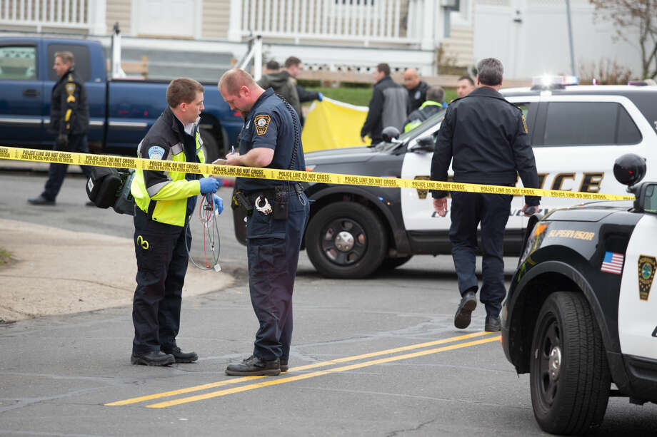Hour photo/Chris Palermo. Norwalk Police respond to an alleged suicide on the corner of Larsen and South Main Street in South Norwalk Monday morning.