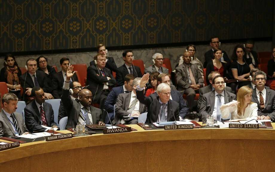 Members of the Security Council vote in favor of putting North Korea's human rights situation on the council's agenda during a meeting on Monday, Dec. 22, 2014 at United Nations headquarters. It appeared to be the first time that any country's human rights situation has been scheduled for ongoing debate by the U.N.'s most powerful body. The meeting also came in the shadow of the United States accusing North Korea of a devastating hacking attack. (AP Photo/Frank Franklin II)