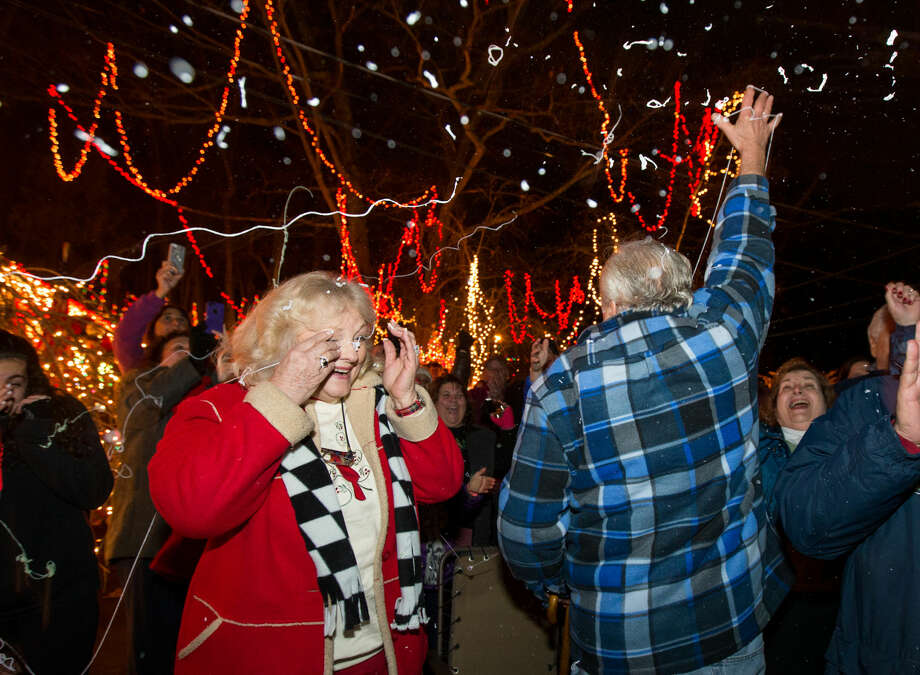 "Hour photo/Chris Palermo. The Setti's are doused with silly string as the celebrate winning ABC's ""Light Fight"" competition surrounded by family, friends, and supporters Monday night at their Christmas Village."