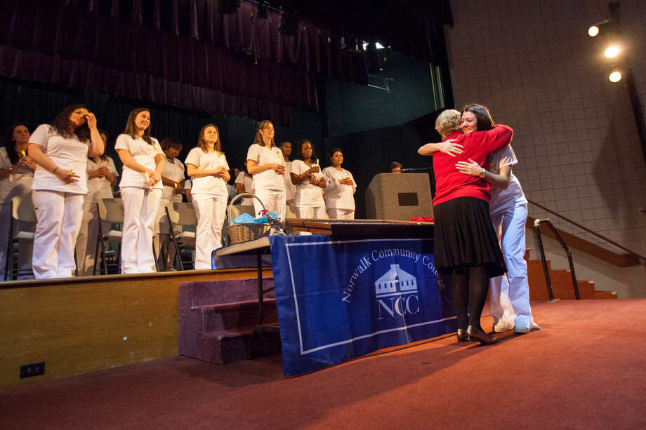 Hour photo/Chris Palermo. Students recieve their pins during the Norwalk Community College Division of Nursing and Allied Health graduation and pinning ceremony at the East Campus Monday evening.