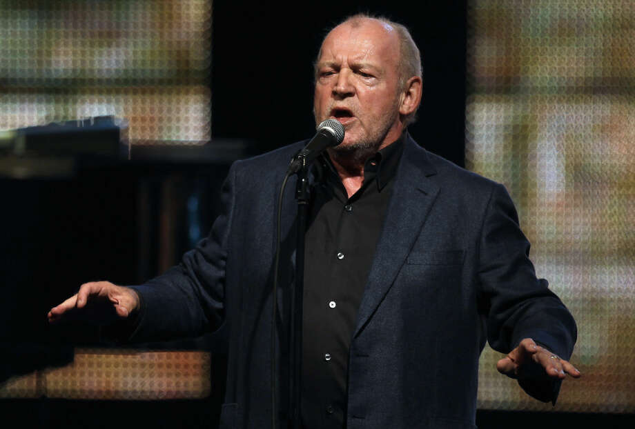 """FILE - In this Aug. 5, 2011 file photo, British singer Joe Cocker sings the """"Red Cross Gala"""" in Monaco. Cocker, best known for the songs, """"You Are So Beautiful,"""" and the 1980s duet """"Up Where We Belong,"""" with Jennifer Warnes, died Monday, Dec. 22, 2014 of lung cancer in Colorado. He was 70. (AP Photo/Lionel Cironneau, File)"""