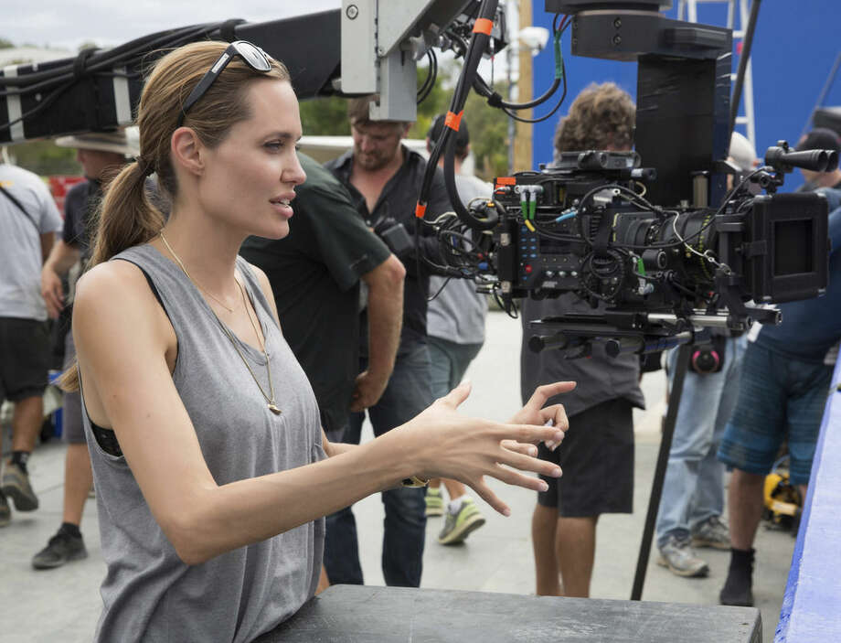 """In this image released by Universal Pictures, director Angelina Jolie appears on the set of """"Unbroken."""" (AP Photo/Universal Pictures, David James)"""