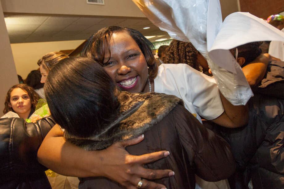 Hour photo/Chris Palermo. Carmel Joseph gets a hug from her sister after the Norwalk Community College Division of Nursing and Allied Health graduation and pinning ceremony at the East Campus Monday evening.