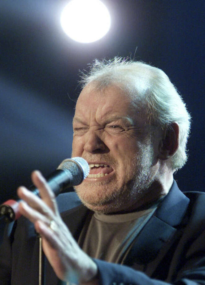 "FILE - In this March 23, 2002 file photo, British singer Joe Cocker performs during the television game show ""Bet It...?!"" ('Wetten Dass...?!') in Munich, southern Germany. Cocker, best known for the songs, ""You Are So Beautiful,"" and the 1980s duet ""Up Where We Belong,"" with Jennifer Warnes, died Monday, Dec. 22, 2014 of lung cancer in Colorado. He was 70. (AP Photo/Ralph Orlowski, Pool)"
