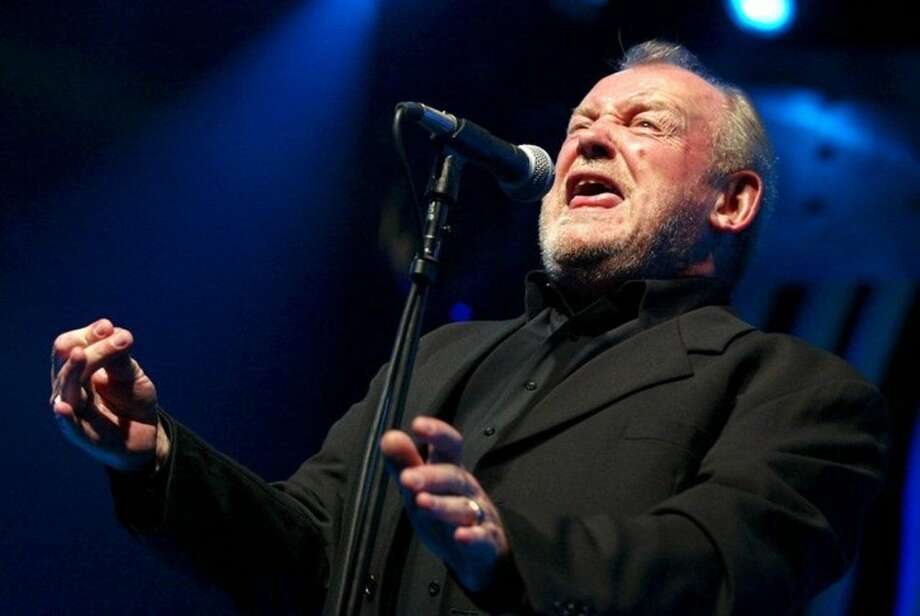 "FILE - In this July 20, 2002 file photo, British Rock and Blues legend Joe Cocker performs on stage of the Stravinski hall during the Montreux Jazz Festival, in Montreux, Switzerland. Cocker, best known for the songs, ""You Are So Beautiful,"" and the 1980s duet ""Up Where We Belong,"" with Jennifer Warnes, died Monday, Dec. 22, 2014 of lung cancer in Colorado. He was 70. (AP Photo/Keystone, Fabrice Coffrini, File)"