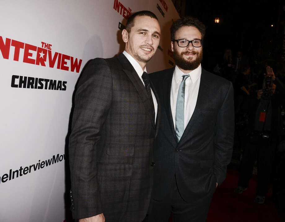 "FILE - In this Dec. 11, 2014 file photo, actors Seth Rogen, right, and James Franco attend the premiere of the Sony Pictures' film ""The Interview"" in Los Angeles.Sony Pictures Entertainment announced Tuesday a limited theatrical release of ""The Interview"" beginning Thursday, putting back into the theaters the comedy that prompted an international incident with North Korea and outrage over its cancelled release. Sony Entertainment CEO Michael Lynton said Tuesday that Seth Rogen's North Korea farce ""will be in a number of theaters on Christmas Day."" He said Sony also is continuing its efforts to release the film on more platforms and in more theaters. (Photo by Dan Steinberg/Invision/AP, File)"