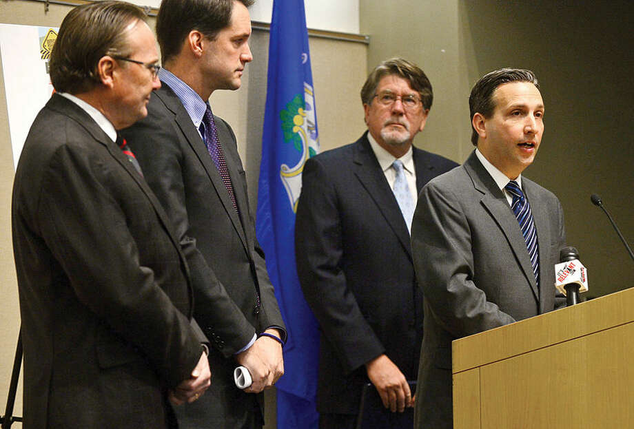 Congressman Jim Himes discusses the recent transportation infrastructure study completed by TRIP, a national transportation research group, during a news conference at the University of Connecticut's Stamford campus Tuesday, as Jack Condlin, president and CEO of the Stamford Chamber of Commerce, state Senator Bob Duff and Will Wilkens, executive director of TRIP, look on.