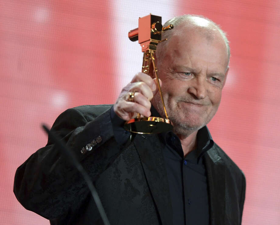 "FILE - In this Feb. 2, 2013 file photo, British singer Joe Cocker speaks after receiving the lifetime achievement award for music during the 48th Golden Camera award ceremony in Berlin, Germany. Cocker, best known for the songs, ""You Are So Beautiful,"" and the 1980s duet ""Up Where We Belong,"" with Jennifer Warnes, died Monday, Dec. 22, 2014 of lung cancer in Colorado. He was 70. (AP Photo/Maurizio Gambarini, File)"
