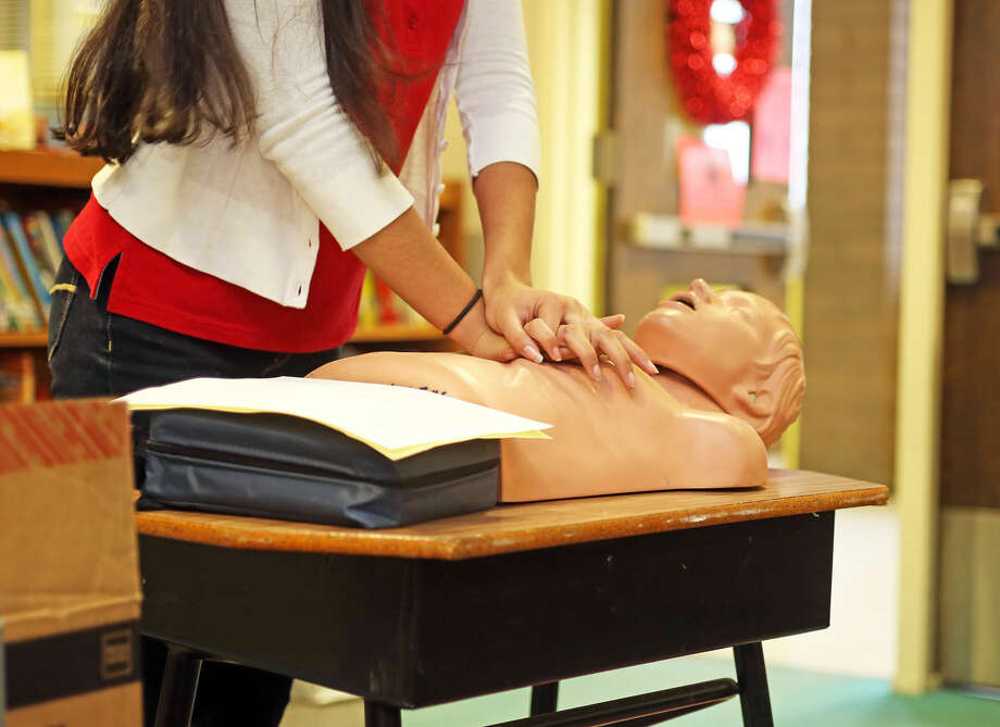 Mahika Jhangiani, a senior at Norwalk High School, gives a CPR class at Marvin Elementary School Monday afternoon as a part of her Project Explore senior project. Hour Photo / Danielle Calloway