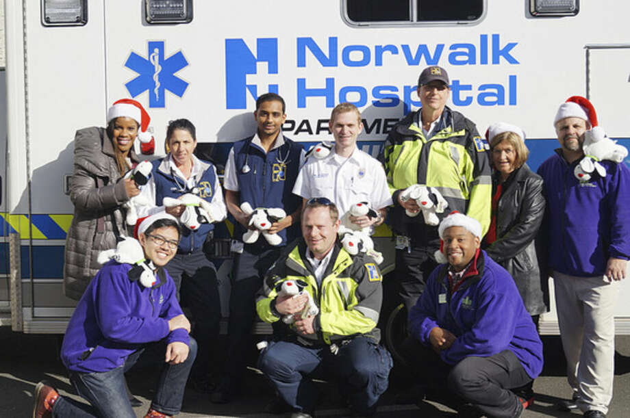 Stepping Stones Museum for Children's Kishshana Palmer, Director of Development; Eric Capina, Visitor Experience Lead; Robert Townes, Manager of Community Advocacy; Linda McDonald, Manager of Donor Stewardship and Mike Jacabacci, Director of Facilities share a laugh with a group of Norwalk Hospital EMTs and Paramedics outside of the hospital's state-of-the-art Emergency Department. The Stepping Stones staff members delivered 80BooZoo™ plush toys to Norwalk Hospital's Emergency and Pediatric Departments.