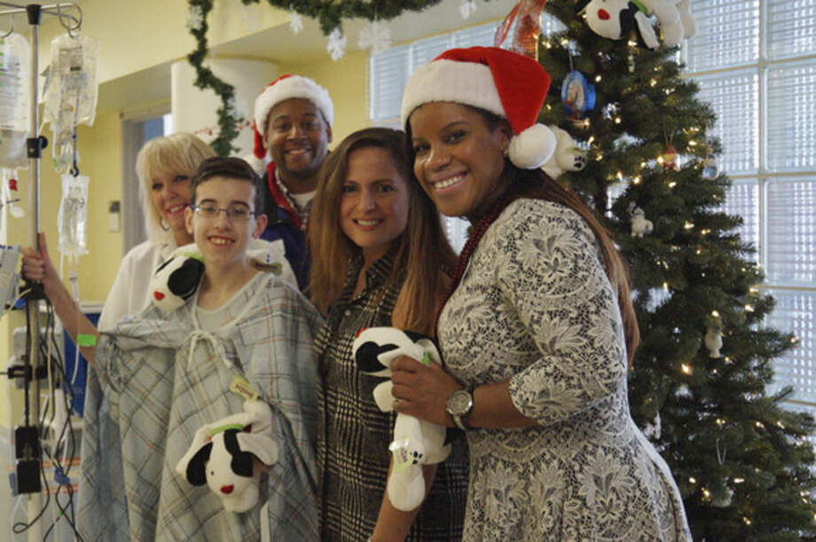 Contributed photoStepping Stones Museum for Children staffers get ready to make a special delivery to Norwalk Hospital.