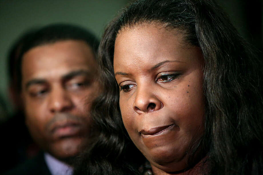 Janet Baker, mother of the late Jordan Baker, appears at the Harris County Criminal Justice Center, Tuesday, Dec. 23, 2014, in Houston, after a grand jury declined to indict Houston police officer Juventino Castro in the shooting death of 26-year-old Baker. Castro shot Baker on Jan. 16, while off duty but in uniform, working security at a mall. (AP Photo/Houston Chronicle, Gary Coronado) MANDATORY CREDIT