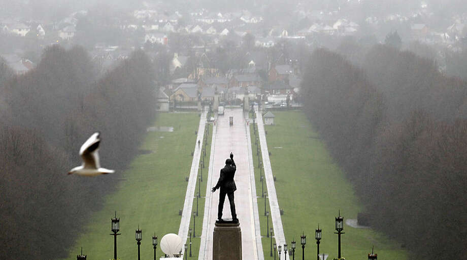 A statue of 1920's Ulster Unionist politician Edward Carson overlooks the grounds of Stormont estate, near Belfast Tuesday, Dec. 23, 2014. All-party talks involving the five main political parties in Northern Ireland continued overnight with the British and Irish governments as politicians try to find a solution on a number of issues hampering power-sharing. (AP Photo/Peter Morrison)