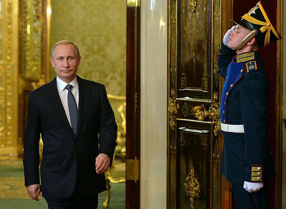Russian President Vladimir Putin, left, enter a hall for a meeting of CSTO (Collective Security Treaty Organization) in Moscow's Kremlin, Russia, Tuesday, Dec. 23, 2014.(AP Photo/RIA Novosti, Alexei Druzhinin, Presidential Press Service)