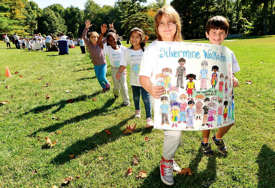 Hour photo / Erik Trautmann Silvermine Elementary School 2nd graders Giana Degroat and Tyler Quick participate in their annual walkathon Friday afternoon as part of their fundraising effort.