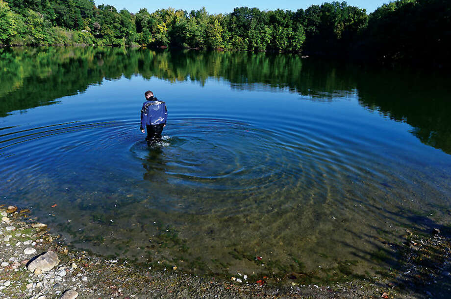 Hour photo / Erik Trautmann Wilton police officer Paul Lichtenberger checks the water before the Wilton and Westport Police and Fire Departments conduct water rescue training with their dive units Thursday morning in Wilton.