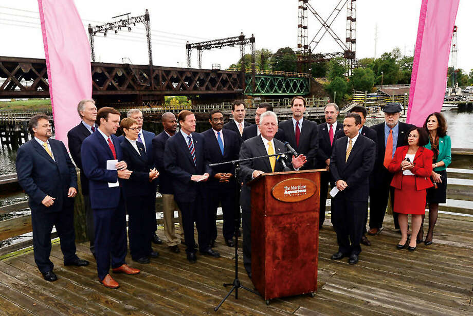 Hour photo / Erik Trautmann Norwalk Mayor Harry Rilling speaks during a news conference held by Governor Dannel P. Malloy Thursday morning highlighting the planned replacement of the Walk Bridge, the 118-year old bridge that serves on Metro-North's New Haven Line. U.S. Senator Richard Blumenthal, Congressman Jim Himes, Mayor Harry W. Rilling, State Senator Bob Duff, Department of Transportation Commissioner James P. Redeker, Connecticut Commuter Rail Council Vice Chairman John Hartwell, commuter advocate Jim Cameron, and other local officials joined the governor in the announcement.