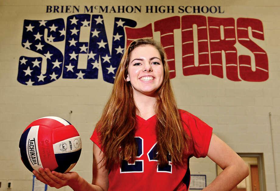 Hour photo / Erik Trautmann Claire Kostohryz is TheHour's 2014 All-Area volleyball MVP