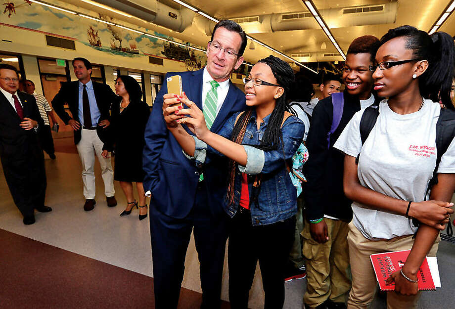 Hour photo / Erik Trautmann Connecicut Governor Dannell Malloy takes a selfie with student Chanya Champagne following the J.M. Wright Technical School Opening Day ribbon cutting ceremony Wednsaday morning.