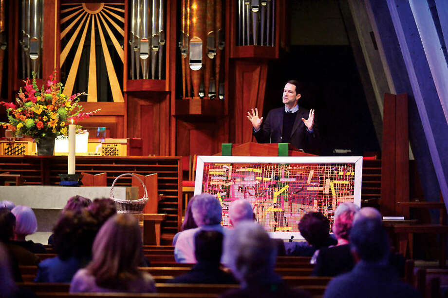 Hour photo / Erik Trautmann U.S. Rep. Jim Himes discusses immigration reform with representatives from Presbyterian congregations in Connecticut, Rhode Island and Massachusetts at the First Presbyterian Church of Stamford.