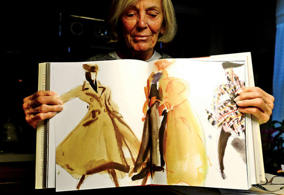 Hour photo / Erik Trautmann Norwalk resident Rosemary Eula displays the new New York Times book Eula, a biography of her late brother-in-law, fashion sketch artist Joe Eula.