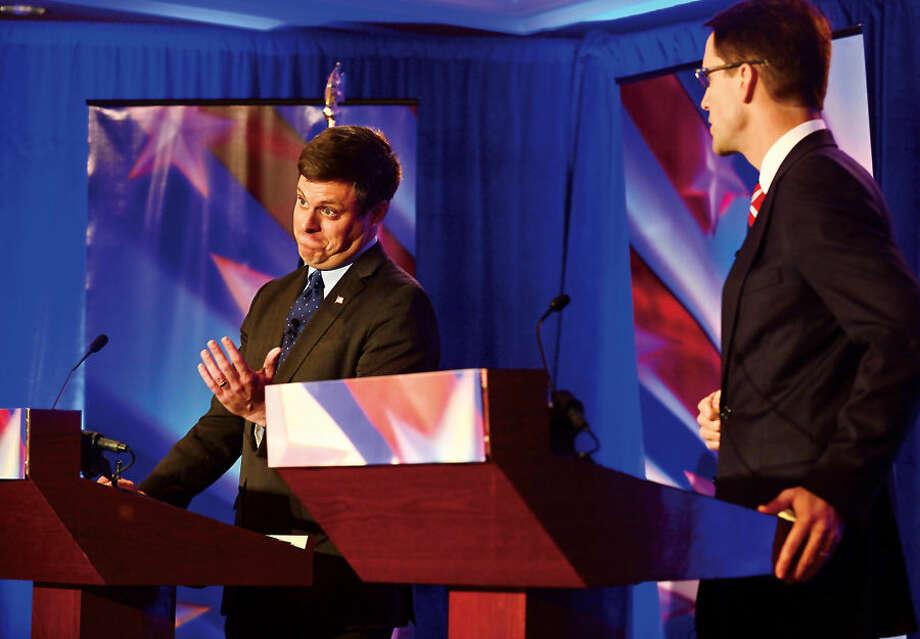Hour photo / Erik Trautmann Connecticut Congressman Jim Himes and GOP challenger Dan Debicella debate at the Norwalk INN Tuesday afternoon.