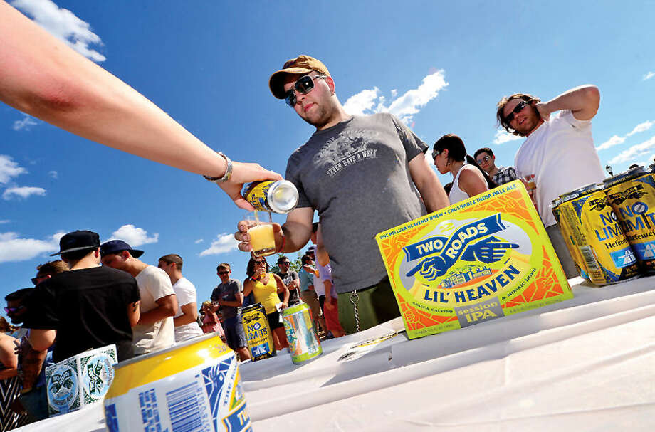 Hour photo / Erik Trautmann 500 people enjoy 18 different craft breweries from around new england poured more than 50 different beers at Ninety9 Bottles' first ever Craft Beer Festival at Oyster Shell Park Saturday.