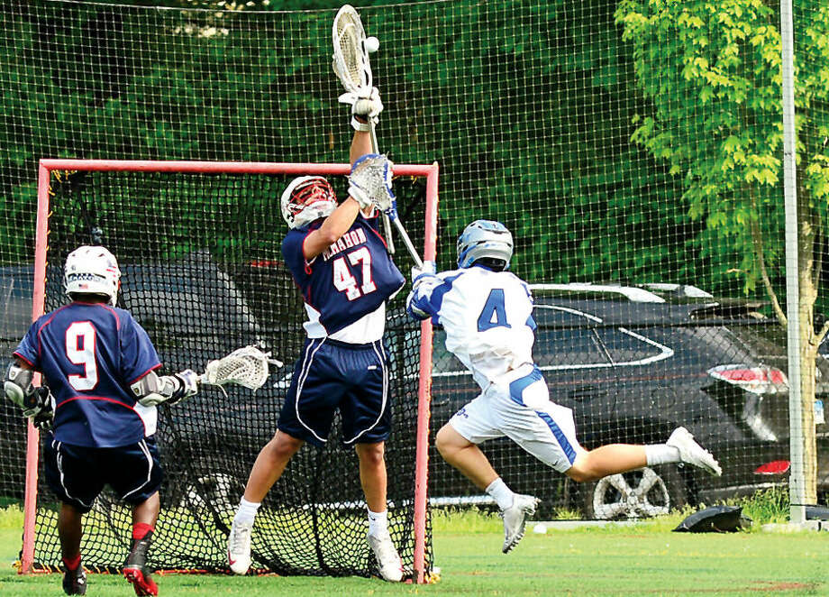 Hour photo / Erik Trautmann Brien McMahon's against Darienin their FCIAC game Friday