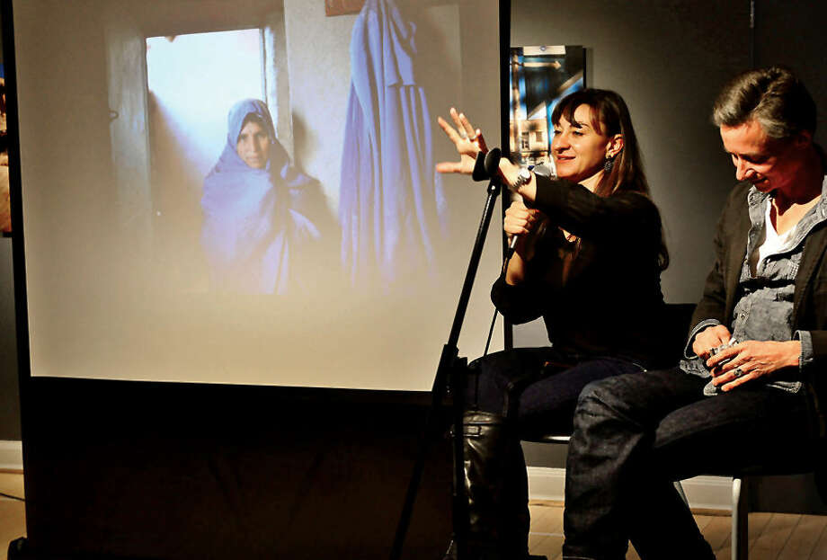 """Hour photo / Erik Trautmann Westport native and renown photojournalist Lyndsey Addario holds a panel discussion with fellow photojournalist Spencer Platt at the Westport Arts Center Saturday as part of her book release, """"On the Wire: Veiled Rebellion""""."""