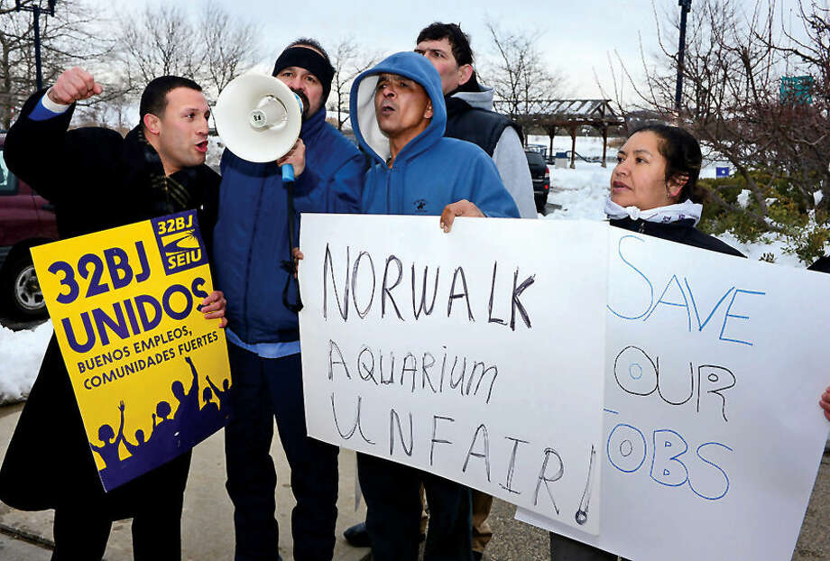 Hour photo / Erik Trautmann Supporters of local 32BJ United and the workers that fired from the Maritime Aquarium hold a rally outside the Aquarium Saturday afternoon demanding their jobs back.