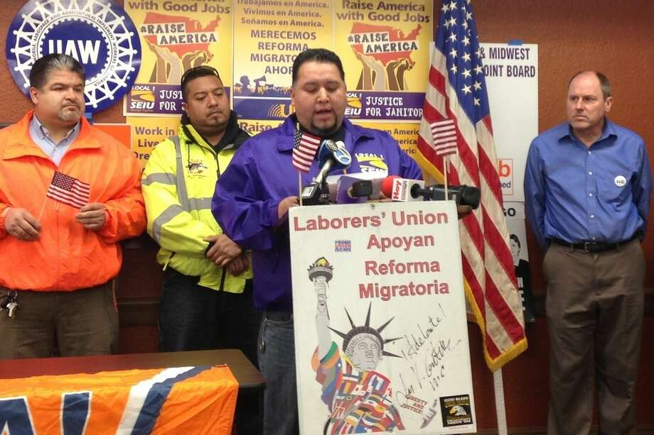 In this Dec. 2, 2014 photo, Felipe Diosdado speaks about how President Obama's executive action on immigration will help him and his family during a news conference in Chicago. Diosdado, 36, came to the U.S. illegally in 1997 and is now a member of the Service Employees International Union Local 1. Unions like SEIU are reaching out to immigrants affected by Obama's action in hopes of expanding labor's dwindling ranks. (AP Photo/Sara Burnett)