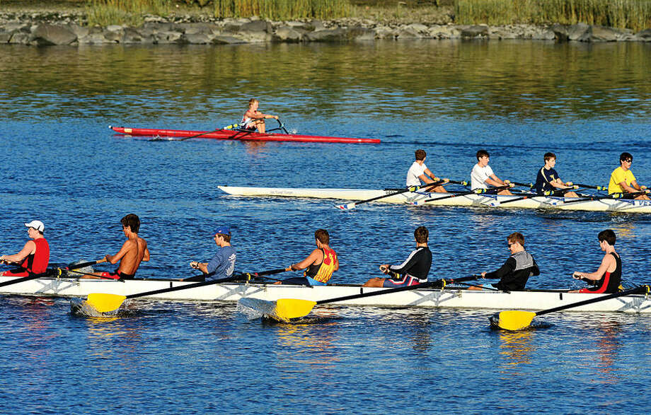 Hour photo / Erik Trautmann Rowing clubs take to the water on the Norwalk River in the summer of 2014.