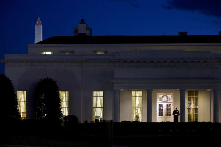 """FILE - In this Nov. 20, 2014, file photo, a Marine stands guards outside the West Wing of the White House in Washington, signifying that President Barack Obama is working inside. After taking a shellacking in the November midterm elections, many Democrats remain confident that the 2016 presidential landscape still tilts in their favor. Republicans, meanwhile, are out to disprove the idea of an enduring """"Obama coalition."""" (AP Photo/Jacquelyn Martin, File)"""