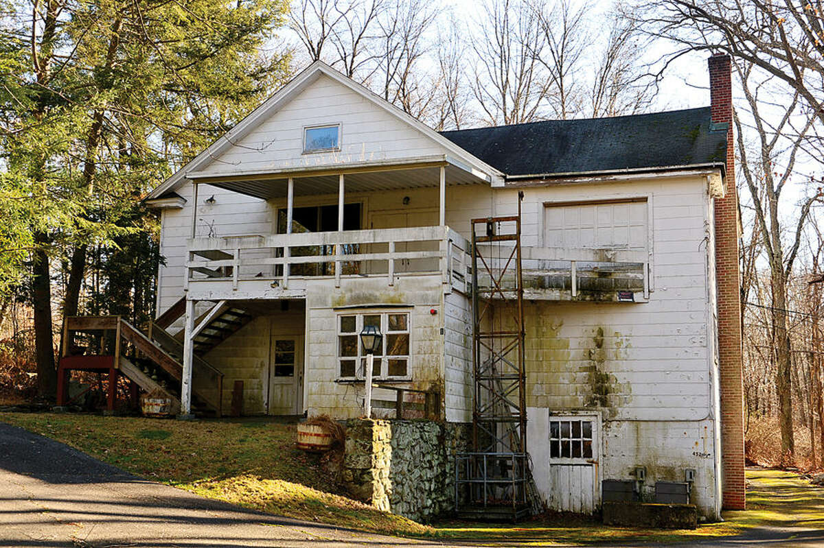 Hour photo / Erik Trautmann A developer has proposed building 21 single-family homes on the White Barn Theater property on Newtown Avenue. The plan would leave half of 15.4-acre property as conservation easement but eliminate the renown theater and other buildings.